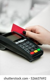 Woman hand using payment terminal in  shop. Paying with credit or debit card, credit card reader. Finance and banking concept. Buy & Sell  service and product.