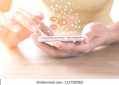 woman hand using smart phone with technology social media and network icon