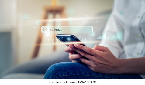 Woman hand using smartphone and press screen to search Browsing on the Internet online.