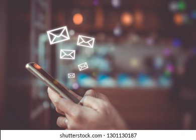 Woman hand using smartphone and it's show 1 email recieve notification icon pop up on screen of mobile phone. Business communication  technology concept.