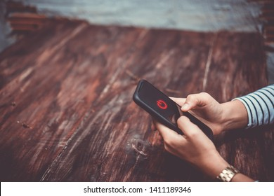 Woman hand using smartphone to switch off or shut down online and social connection. Business, financial, trade stock maket and social network concept.