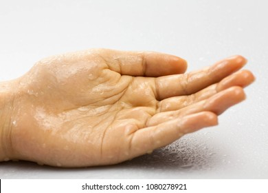 woman hand wet closeup isolated on white background.