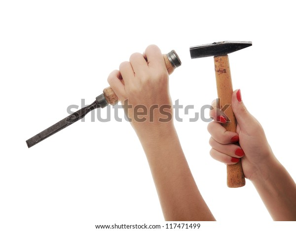 woman hand working with hammer and chisel