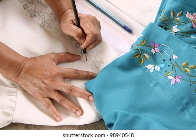 woman hand working on paper. texture design for handmade clothes