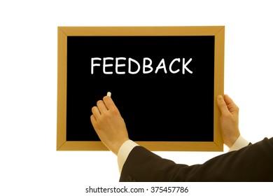 woman hand writing feedback word on a small blackboard