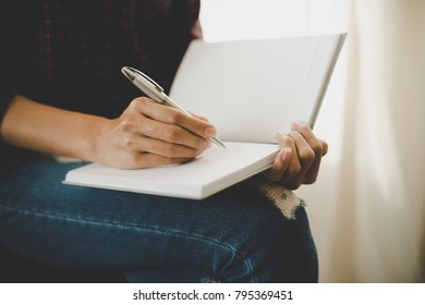 Woman hand writing on notebook. Education concept