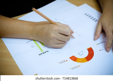 Woman hand writing with pencil, on working table Business and education concept.