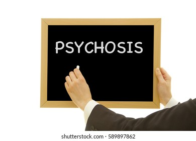 Woman hand writing PSYCHOSIS on chalkboard isolated on white background.