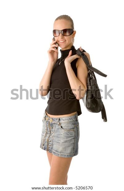 the woman with handbag and mobile phone