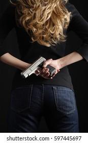 A woman with a handgun.