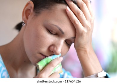 woman with handkerchief having cold with fever