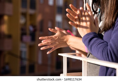 Woman hands applauding medical staff from their balcony. People in Spain clapping on balconies and windows in support of health workers, doctors during the Coronavirus pandemic. Selective Focus