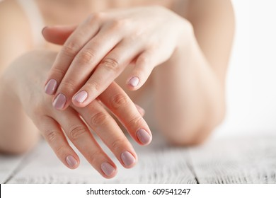 woman hands applying moisturizing cream to her skin