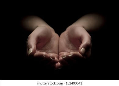 Woman hands begging with outstretched hands. Hands forming a cup.
