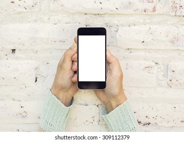 Woman hands with blank cell phone, mock up