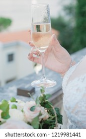 Woman Hands with champagne in glass