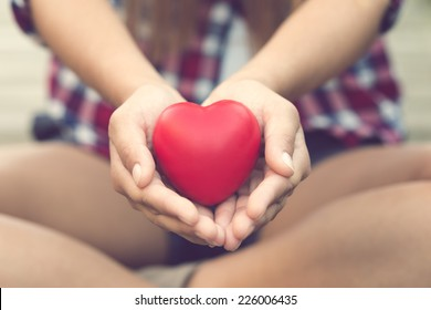 Woman hands giving a heart for you