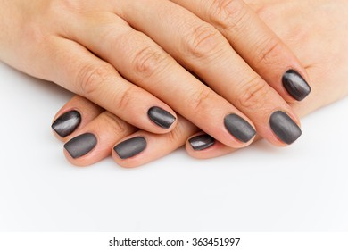 Woman hands with grey nails