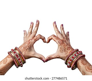 Woman hands with henna doing heart gesture isolated on white background with clipping path