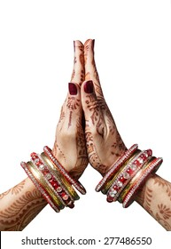Woman hands with henna in Namaste mudra on white background