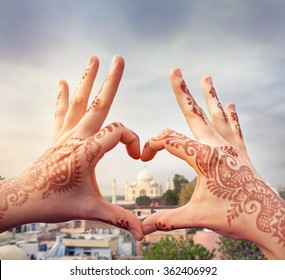 Woman hands with henna painting in shape of heart with Taj Mahal in it. I love India concept with copy space.