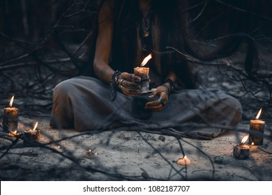 woman hands holding candle close up