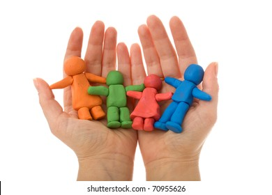 Woman hands holding colorful clay people - united happy family concept, isolated