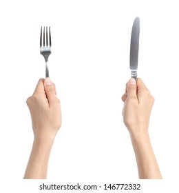 Woman hands holding a fork and a knife isolated on a white background