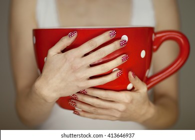 woman hands holding giant coffee cup