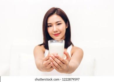 Woman hands holding glass of fresh milk