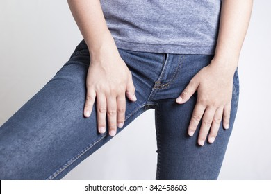 Woman with Hands Holding her Crotch Isolated in a White Background