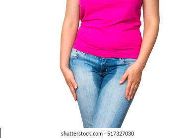 Woman with hands holding her crotch, she wants to pee - urinary incontinence concept