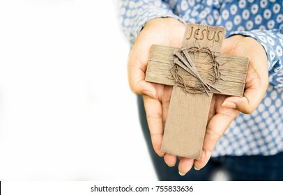 Woman hands holding a holy cross, crown of thorns and nail.Easter and Good friday concept.Worship God concept.The Jesus Christ crown of thorns nail and the holy cross.