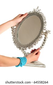 Woman hands holding a mirror
