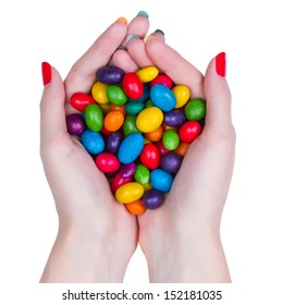 Woman hands holding multi-colored candy isolated on white background