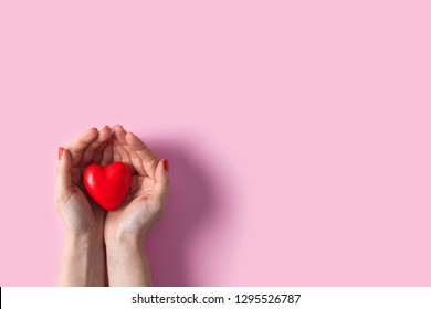 Woman hands holding red heart, health care, donate and family insurance concept, world heart day, world health day, Valentine's day concepts