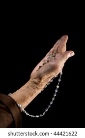 An woman hands in holding a rosary