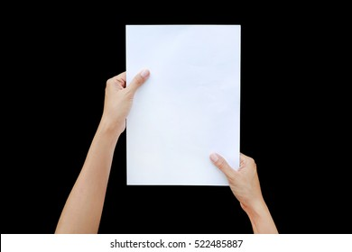 Woman hands holding sheet of paper isolated on black background.