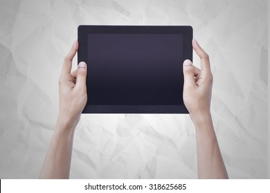 Woman hands holding tablet blank screen over paper background concept use for responsive reading tools and communication pro gadget. website mock up horizontal view, people device pc touch screen