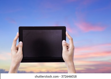 Woman hands holding tablet blank screen over sky background concept use for responsive reading tools and communication pro gadget. website mock up horizontal view, people device pc touch screen