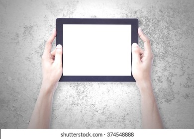 Woman hands holding tablet blank screen over cement background concept use for responsive reading tools and communication pro gadget. website mock up horizontal view, people device pc touch screen