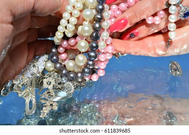 Woman hands and  jewelry on water background, pure water