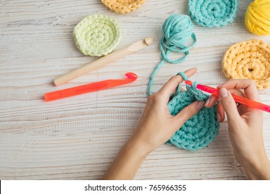 woman hands knitting crochet. hobby crafts things.  Top view. Horizontal composition