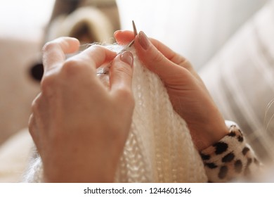 The woman hands knitting woolen clothes. Knitting needles. Close-up. Natural wool. Horizontal photo. Freelance creative working and living concept