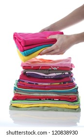 Woman hands with multicolored clothes, isolated background