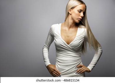Woman With Hands On Hip Standing Over Gray Background