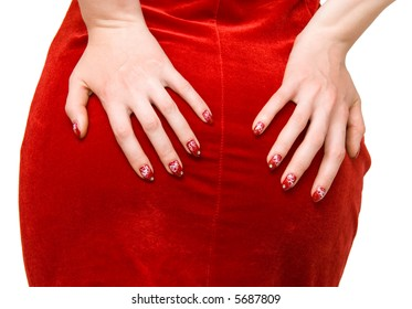 Woman hands on red dress. On white.