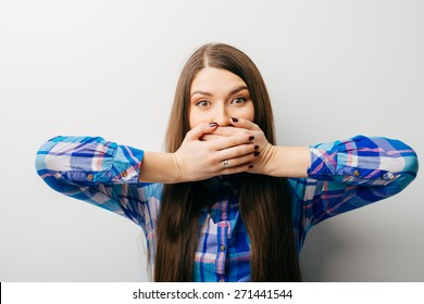 woman with hands over her mouth