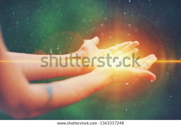 Woman hands praying for blessing from god, blurred nature background, rain, day. Religious human open empty hands with palms up. Gratitude, preacher worship, solitude pray, religion devotion concept