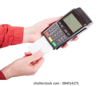 Woman hands put blank white credit card in the terminal on white isolated